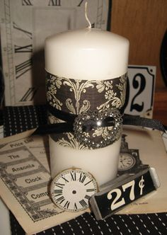 scrapbook paper around a candle w/vintage jewelry