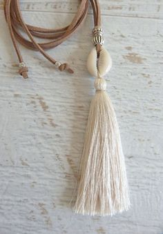 tassel necklace cowrie shell necklace by beachcombershop on Etsy