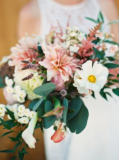 Stylish rustic wedding bouquet: http://www.stylemepretty.com/2016/09/21/stylish-rustic-chic-winery-wedding/ Photography: Anna Peters - http://www.annapetersphoto.com/
