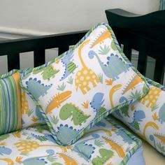 "This is the crib bedding we have for the baby's room! It's called ""Modern Dinosaur"""