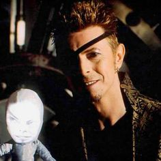 #look how proud he is of his creepy puppet