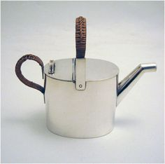 Christopher Dresser silver plated teapot with basket weave handle made for Hukin & Heath c188