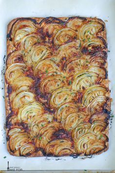 A tender pastry crust topped with sweet roasted onions and just a hint of herbs make this French onion tart a party favorite A sprinkle of thyme and a handful of gruyere pair deliciously with caramelized onions - pizza