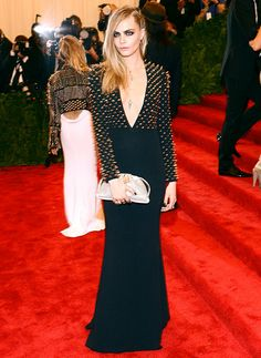 Met Gala 2013:  Cara Delevingne in Burberry / battle of the spikes wit Sienna miller behind her