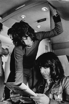 Mick Jagger and Bill Wyman in their private jet, 1972. | rock n roll lifestyle | fly | travel | on tour | black & white | vintage | 1970s | hot lips | the rolling stones | iconic |