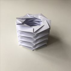 """Collapsible folded paper cylinder using the techniques from """"Folding Techniques for Designers"""" by Paul Jackson"""