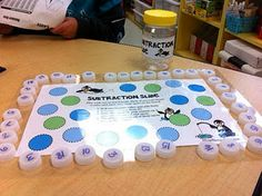 Got water bottle caps? Check out this cute freebie Subtraction Slide game!