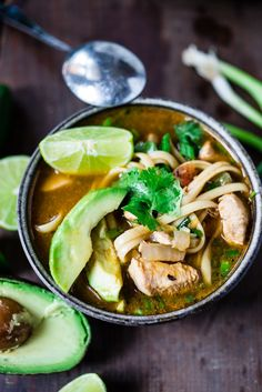 Flavorful, EASY Mexican Chicken Noodle Soup with cilantro, avocado and lime- a one pot meal, in under 30 minutes. Vegan option, sub chickpeas for the chicken!| www.feastingathome.com