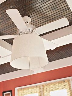 Adding a drum shade to a ceiling fan for a DIY makeover.
