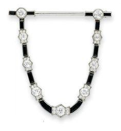 Love this black & white art deco design.  DIAMOND AND ONYX JABOT PIN / CARTIER  / circa 1925 / via Christie's