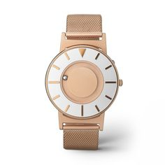 The Bradley Mesh Rose Gold offers a subdued, warm tone softened by a matte finish. Raised markers are brushed with a rose gold hue that matches the case and strap, highlighted by a light silver face around the markers and rose gold center.