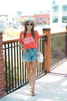 Red tee with denim shorts, Tory Burch miller sandals, round rattan bag, Lack of Color hat, Rayban sunglasses #summer #spring #casual #denim