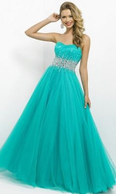 bright blue strapless ballgown dress with a sparkly silver band and sparkles extending up and down away from band