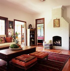 Love these low stools with cushions drawn up to coffee table and loads of colourful rugs Moroccan styling bohemian room
