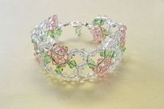 final look of the pink and clear glass bead flower bracelet  http://lc.pandahall.com/articles/3192-how-to-make-a-pink-and-clear-glass-bead-flower-bracelet-for-girls.html