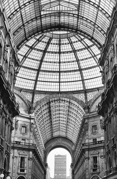 Galleria Vittorio Emanuele II, Milan, Italy | via 亗 Dr. Emporio Efikz 亗 | (A pity about the modern tower-block visible through the archway.)