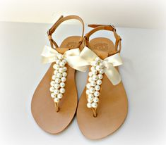 Wedding sandals- Greek leather sandals decorated with white pearls and satin bow -Bridal party shoes- Ivory women flats- Bridesmaid sandals by dadahandmade on Etsy https://www.etsy.com/listing/228544295/wedding-sandals-greek-leather-sandals