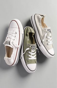 Free shipping and returns on Converse Chuck Taylor® 'Shoreline' Sneaker (Women) at Nordstrom.com. Crisp white canvas is complemented with red and blue stripes on a classic sneaker fitted with hidden elastic at the tongue for easy slip-on wear. The first basketball-specific shoe was the Converse All-Star, released in 1917, and Converse has been producing sporty, iconic American sneakers ever since. Wear them with just about anything.