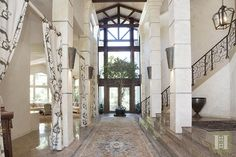 Dramatically Enter Your Private Oasis  ... You are greeted by a magnificent dramatic entry gallery foyer with 30 foot cathedral ceilings, stone pillars, and radiant heated stone floors. Amazing layout in this incredibly designed home in Englewood, NJ on a spectacular piece of private property with verdant gardens, specimen grounds and gazebo with pool. $2,350,000. Learn more at www.halstead.com/9089565