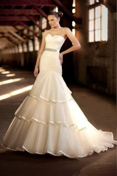 Essense of Australia D1287- royal organza fit and flare gown with lavish satin accents. sweetheart neckline and ruched bodice accent a full tiered skirt finished with lavish satin.