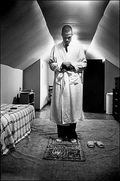 Malcolm X praying....In December 1964 Malcolm X walked into a Manchester mosque and took off his shoes. On his way out, he struggled to find them amongst the footwear that lay between him and the door. The man who eventually found the black size 14s later said, 'We found that they had huge holes in them.' Though hole-ridden shoes would act as a source of embarrassment for political figures today, this confirmed Malcolm X's simplicity and proximity to the poor and needy he tried to serve.