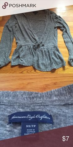 Cute grey sweater Cute sweater from American eagle. Sleeves are rolled up a bit. Drawstring at waist and can tie or leave untied and the sweater open. In great shape American Eagle Outfitters Sweaters Cardigans