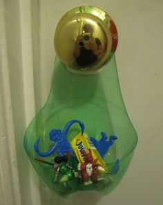 Great idea for keys, change and found hair pins/ties- Clutter Catcher Organizer from a 2 liter bottle Pop Bottles, Plastic Bottles, Doorknob Hangers, Door Hangers, Recycled Bottles, Diy Organization, Organizing Tips, Bottle Crafts, Getting Organized