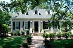 Light brick, black shutters and front door