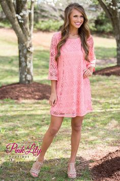 How adorable is this new State of Grace dress?! It has an effortless look and comfortable feel! The trendy coral color and simple scoopneck keeps it cute and feminine, while the gorgeous triangle pattern woven into the fabric creates some trendy eyelets on the 3/4 sleeves and near the bottom hemline.
