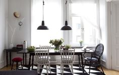 Pendant lights hang over a large dining table.