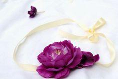 Flower headband with a silk strap.