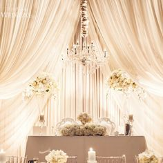 The opulent sweetheart table at this #white and silver #wedding is simply exquisite #wedluxe