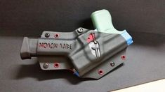 SOB kydex holster with single mag. Molon labe made by quick lock holsters