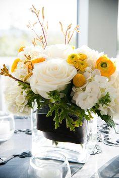 Floral Arrangement:  -white roses, billy balls, ranunculus, succulents, etc.