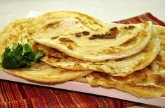 CHAPATTIS OR INDIAN FLAT BREAD Recipe :: 2 1/2 cups fine whole wheat flour, 2 cups of water, pinch of salt.