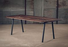 Alon Dodo's Table 121 is made from solid American black walnut, with iron legs.