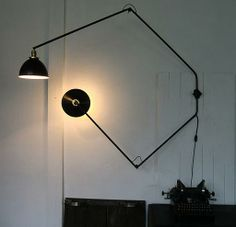 A lot of really unique light fixtures made of vintage parts and interesting metal tubing on this site.