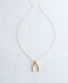 Petite Lucky Wishbone Necklace - available in silver, gold and rose gold. By Olive Yew.
