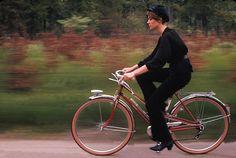 Francoise Hardy rides a bike.