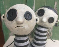 convicts doll art sculpture ceramic or papier mache with buttons little criminals from the alternative world of coraline