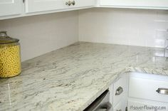 It's Overflowing:  like the granite and drawer pulls.  subway tiles classic