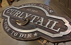 rustic curlytail sign