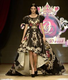 Dramatic entrance: One of the more striking Dosso Dossi looks was a full-skirted dipped-he...
