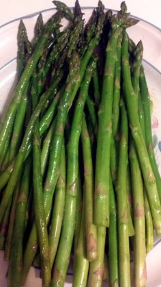 Asparagus..every spring my Dad walked miles picking fresh asparagus off the ditch banks where it grew wild.