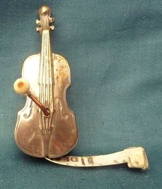 antique vintage silvered violin viola cello shaped sewing measuring tape music