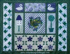 This is my 'Violets & Ivy' quilt. I still love the lattice borders & the violets panel of this design!!