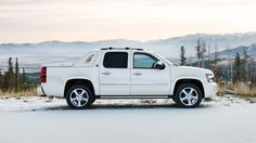 """The Chevy Avalanche Black Diamond Edition SUV truck with 20"""" chrome wheels."""