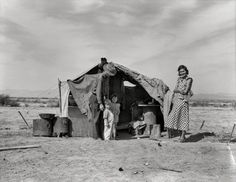 """Spring 1937. """"This family without food and work about to be returned to Oklahoma by the Relief Administration. They have lost a baby as a result of exposure during the winter. Had to sell their tent and car to buy food. Neideffer Camp, Holtville, Imperial Valley, California."""" Photo by Dorothea Lange for the Resettlement Administration. View full size."""