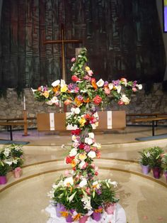 This photo is not of our church, but at our church families are also invited to bring a flower from their yard to decorate the Easter Cross.