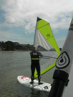 Teaching from a board is a great way to give live coaching tips to those on beginners windsurfing lessons. Here a beginner windsurf student is learning how to hold their position on the water. #poolewindsurfing #windsurfinglessons #pooleharbour